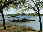 View larger image of Boats docked on lake at LA MANCHA LAKE RESORT image #7