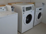 View larger image of Laundry room with washer and dryers at FORT WORTH RV PARK image #2