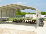 View larger image of Patio with seating area at FORT WORTH RV PARK image #4