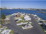 View larger image of Covered deck with barbeque grill and dining table  chairs at SALISH SEASIDE RV HAVEN image #3