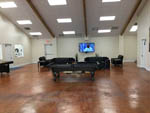 View larger image of Pool table in game room with TV at CRYSTAL LAKE RV RESORT image #3