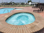 View larger image of Pool and hot tub at CRYSTAL LAKE RV RESORT image #9
