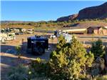 View larger image of Looking at the RV sites from the mountain at GRAND PLATEAU RV RESORT AT KANAB image #6