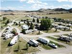 View larger image of Drone view of grassy park with gravel sites at FAIRMONT RV RESORT image #3