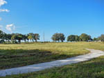 View larger image of Grassy field at TORREY TRAILS RV RESORT image #8