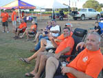 View larger image of Group of seated happy campers at CLEMSON RV PARK AT THE GROVE image #9