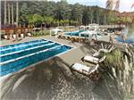 View larger image of Multiple community pools and lounge chairs at CAROLINA PINES RV RESORT image #9