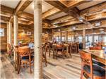 View larger image of Interior of modern restaurant with wooden tables hardwood floor and wooden walls at BLUE WATER RV RESORT image #5
