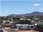 View larger image of Covered wagon parked near entrance at DESERT SANDS RV PARK image #2