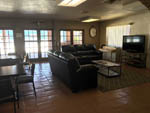 View larger image of Interior of lobby with sofas and TV at DESERT SANDS RV PARK image #6