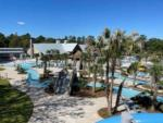 View larger image of Aerial view of two people floating in water at SPLASH RV RESORT  WATERPARK image #1