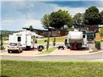 View larger image of A couple of RVs in their spots at THE RIDGE OUTDOOR RESORT image #1