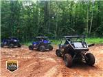 View larger image of Three ATVs headed off into the woods at IRON MOUNTAIN RESORT image #9
