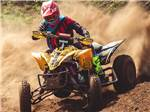 View larger image of An ATV sliding around a dirt turn at IRON MOUNTAIN RESORT image #11