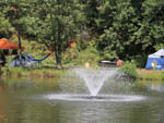View larger image of Fountain in water tents on the grassy shore at JENNYS CREEK FAMILY CAMPGROUND image #4