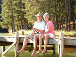 View larger image of Mature couple fishing from a dock at PRESERVATION POINT RV RESORT image #2