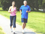 View larger image of Couple jogging through the park at PRESERVATION POINT RV RESORT image #3