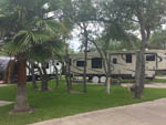 View larger image of Trailer on concrete site with grass area at LAGOONS RV RESORT image #3