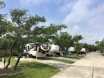 View larger image of Row of RVs parked in sites at LAGOONS RV RESORT image #4