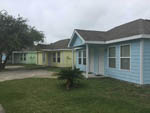 View larger image of Row of 4 colorful cabins at LAGOONS RV RESORT image #7