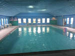 View larger image of Indoor pool with floating beach ball at LAGOONS RV RESORT image #8