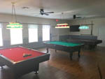 View larger image of Game room with 3 pool tables at LAGOONS RV RESORT image #9
