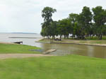 View larger image of Campsites on grassy shore of the lake at BROWDERS MARINA RV PARK  CAMPGROUND image #1