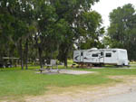 View larger image of Trailer parked in a site with picnic table at BROWDERS MARINA RV PARK  CAMPGROUND image #4