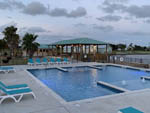 View larger image of Swimming pool and chaise lounges at R  R RV RESORT  CASITAS image #3