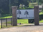 View larger image of Park sign at gated entrance at EASTERN PINES RV PARK image #6