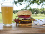 View larger image of Glass of beer hamburger and golf balls at OAK TERRACE RV RESORT image #5
