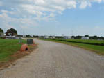 View larger image of One of the gravel roads at SHARK TOOTH RV RANCH image #2