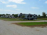 View larger image of A row of gravel RV sites at SHARK TOOTH RV RANCH image #4
