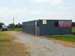 View larger image of A row of cargo containers used as mini storage at SHARK TOOTH RV RANCH image #6