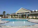 View larger image of View of swimming pool and office at JETSTREAM RV RESORT AT NASA image #1