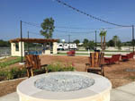 View larger image of Fire pit and outdoor seating at JETSTREAM RV RESORT AT NASA image #2