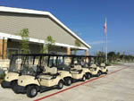 View larger image of Golf carts lined up at office at JETSTREAM RV RESORT AT NASA image #6