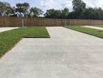 View larger image of Grass site with a concrete pad at TEXAS RV PARK image #5