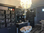 View larger image of Interior with coffee bar and items for sale at TEXAS RV PARK image #6