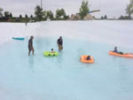 View larger image of Adults supervising kids on rafts at KASOTA RV RESORT image #4