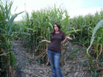 View larger image of Woman standing in the corn maze at KASOTA RV RESORT image #5