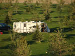 View larger image of An RV among grassy sites at KASOTA RV RESORT image #6