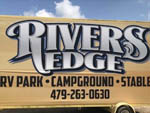View larger image of Sign at the park entrance at RIVERS EDGE RV PARK AND STABLES image #2