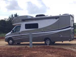 View larger image of Class C RV parked in a site at RIVERS EDGE RV PARK AND STABLES image #3