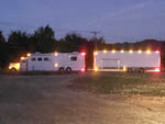 View larger image of Large RV with a trailer at night at RIVERS EDGE RV PARK AND STABLES image #4