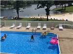 View larger image of Sites with picnic benches and barbecue pits at CROWN LAKE RV RESORT image #1