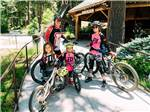 View larger image of A family standing with their bikes at SKYPARK CAMP  RV RESORT image #4