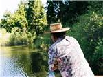 View larger image of A man in a hat flyfishing at SKYPARK CAMP  RV RESORT image #6