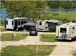 View larger image of A row of RV sites by the water at CAMP LANGSTON RV RESORT image #3