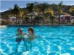 View larger image of Couple swimming at PECHANGA RV RESORT image #3